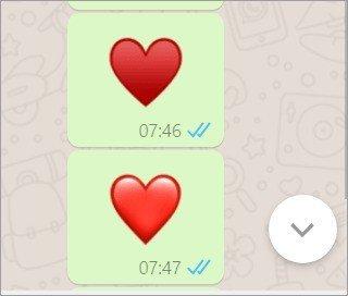 Comparação entre os emojis de coração vermelho e coração de copas